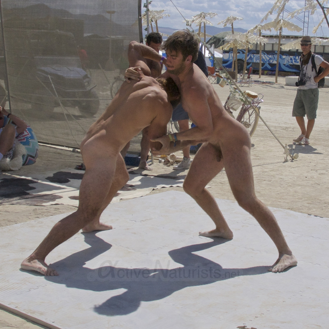 Nude men wrestle